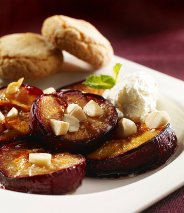 Recipe Roasted Brown Sugar Plums with Amaretto Whipped Cream - mydish