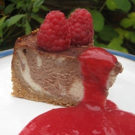 Banana and Chocolate Swirl Cheesecake with raspberry coulis